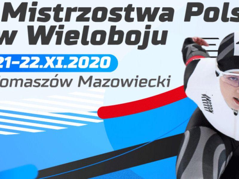 Na zdjeciu baner Mistrzostw Polski w Wieloboju na Arenie Lodowej. Na banerze postać łyżwiarki podczas wyscigu łyżwiarskiego