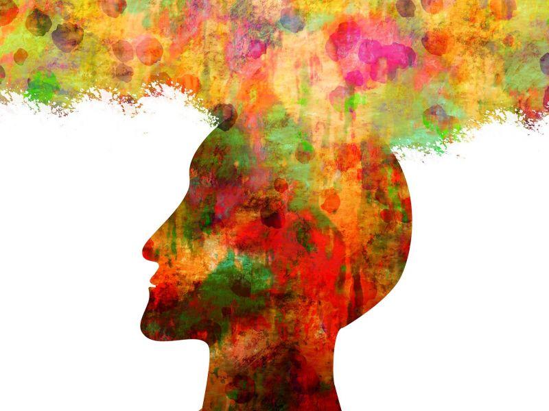 Gafika: białe tło, na nim kolorowa głowa z profiu, z której wydobywa się wtym samym kolorze rodzaj dymu